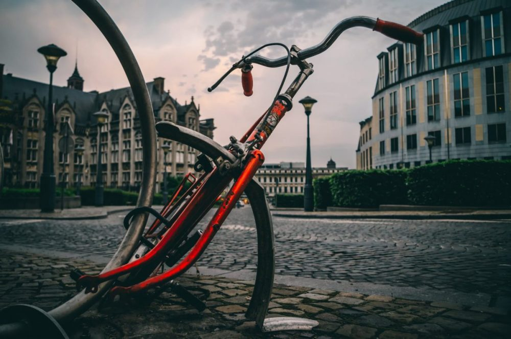 close up photography of red and black road bike frame